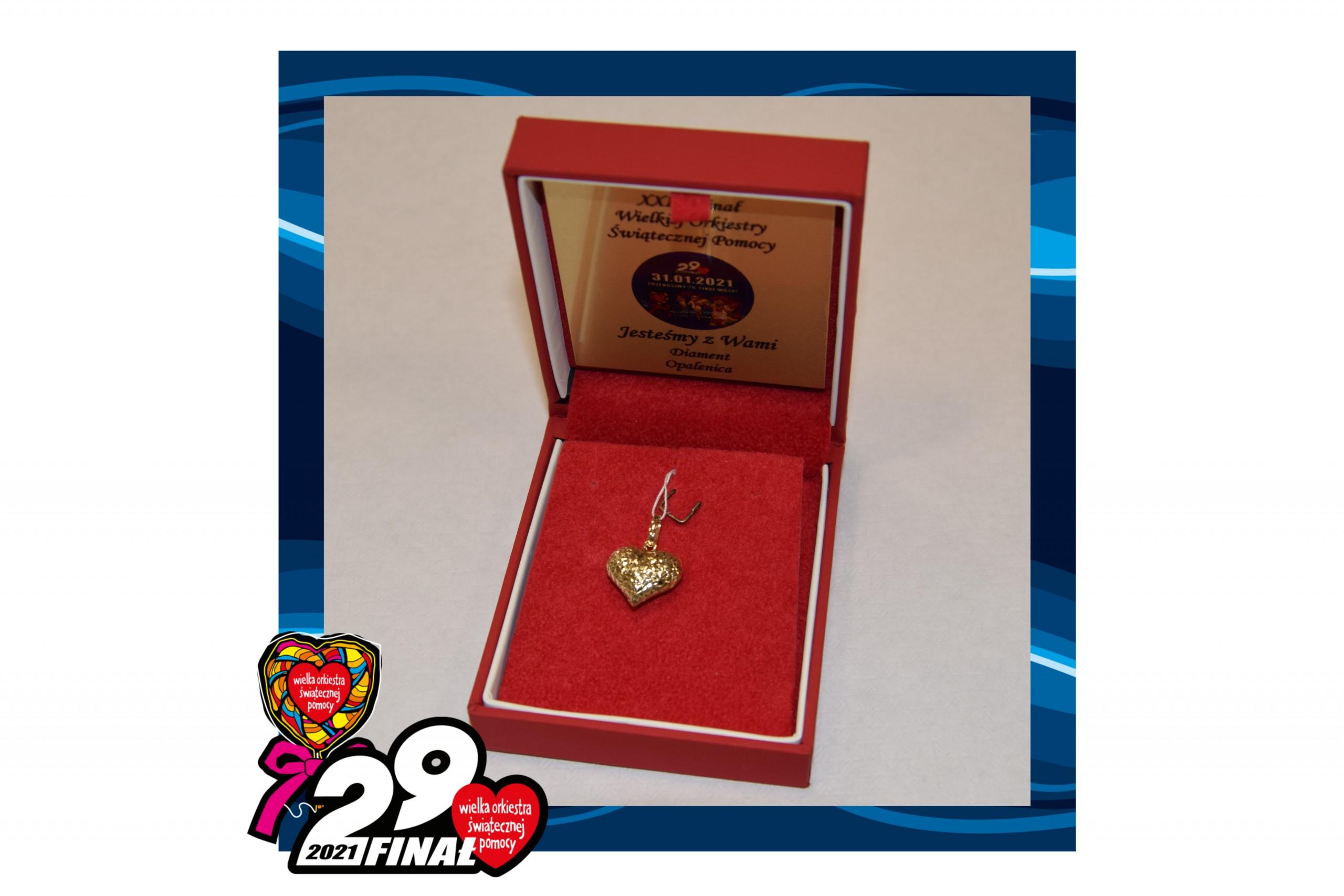w ramce 29 finału wośp zdjecie czerwonego pudełka ze złotym sercem w środku