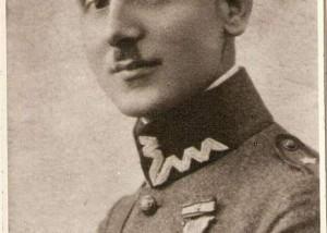 na zdjeciu młody mężczyzna z wąsem. ma na sobie mundur. zdjecie pochodzi z początku 20 wieku. podpis pod zdjeciem: Stefan Zielewicz